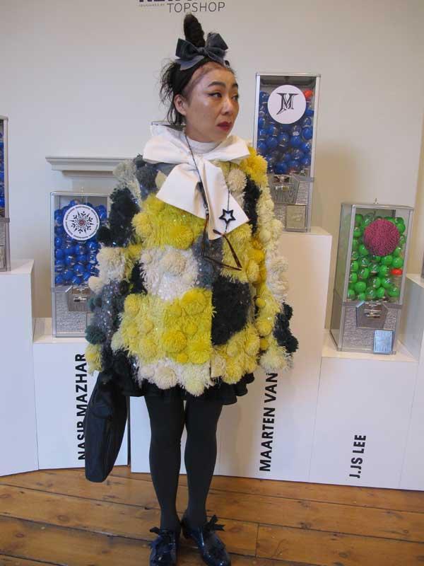 London Fashion Week 2013 - Asian women in yellow dress
