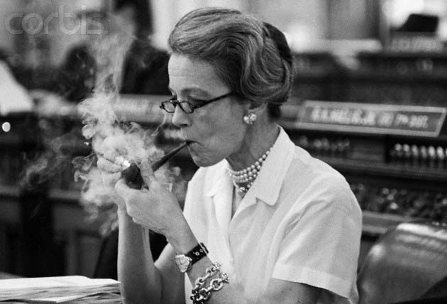 Millicent and Congress smoking a pipe