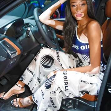 Winnie-Harlow-sits-inside-the-all-new-Jaguar-E-PACE