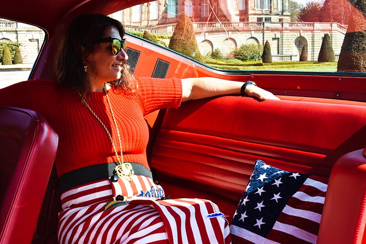 Gracie Opulanza wearing Dolce gabbana skirt in a vintage mustang (1)