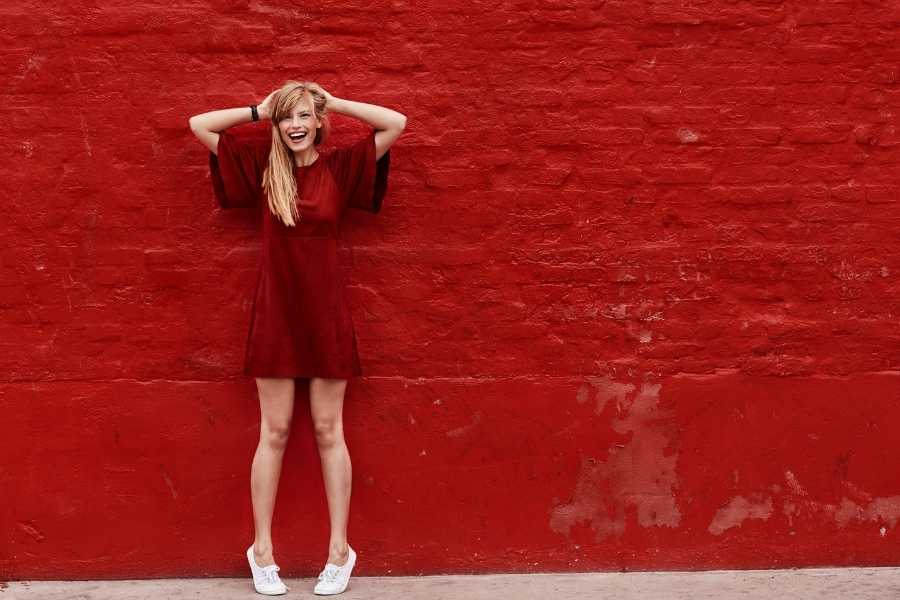 red wall red dress