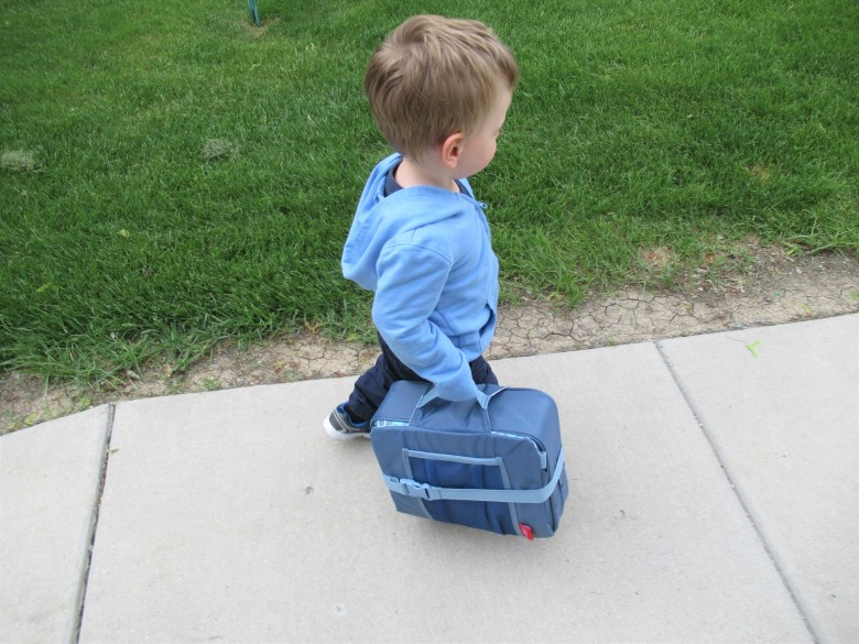 This booster seat is easy to fold and carry for trips and outings.