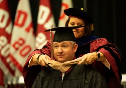 MBA graduate receives hood