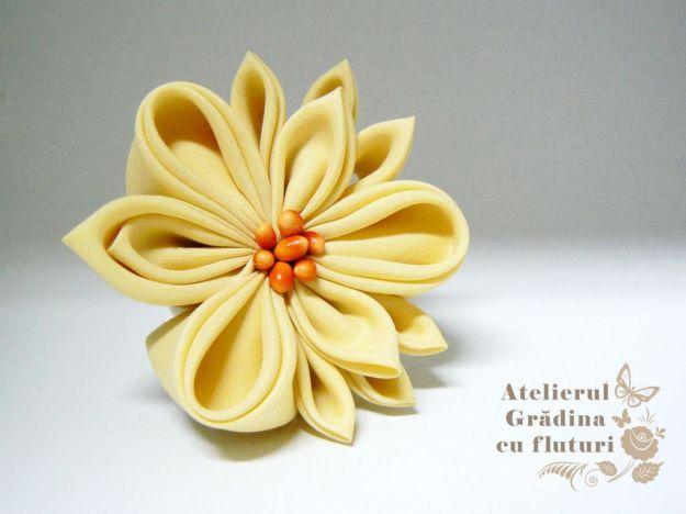 floare galbena matase logo