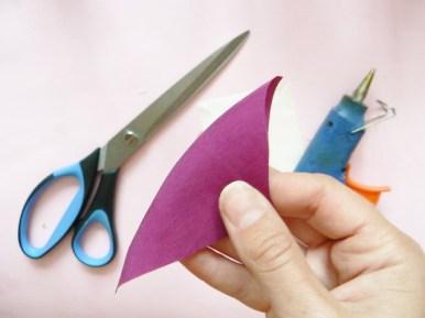 Fold it in two diagonally.