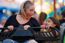Jacie Babb, left, 21, a cosmetology major at Central Georgia Technical College, from Warner Robins, Georgia, and Ryley Church, right, 4, from Warner Robins, Georgia, attend the Georgia National Fair on Saturday, October 7, 2017, in Perry, Georgia. Babb has a season pass to the fair, and she comes every day that it is open; she brought Church, a family friend, and together, they ride the Sizzler. (Photo/Marlee A. Middlebrooks)