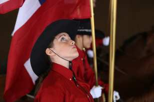 Sylvia O'Neal, 12, from Meriwether County in Georgia, looks at the American flag she is holding during her competition with the Georgia Stampede drill team on Saturday, October 7, 2017 at the Georgia National Fair in Perry, Georgia. (Photo/Mary Grace Heath)