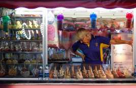 A woman works in a concession stand at the Georgia National Fair in Perry, Georgia, on Friday, October 6, 2017. This is the 28th year that the fair has been held. (Photo/Chamberlain Smith)