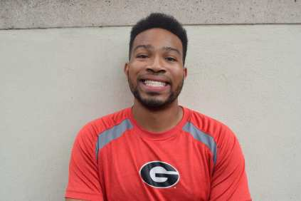 Langston Leake, 21, a history and political science major at the University of Georgia, participates as a member of the Spike Squad during the Georgia vs. Tennessee football game at Sanford Stadium, on September 29, 2018. Leake waits outside the stadium in normal clothes before sitting in the student section and donning paint, spiked shoulder pads and other costume pieces to support the Georgia Bulldogs.