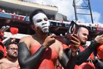 Langston Leake, 21, a history and political major at the University of Georgia, participates as a member of the Spike Squad during the Georgia vs. Tennessee football game at Sanford Stadium, on September 29, 2018. Inside Sanford Stadium, Leake paints his face to resemble a skull as part of his Spike Squad persona as his peers don their costumes and paint.