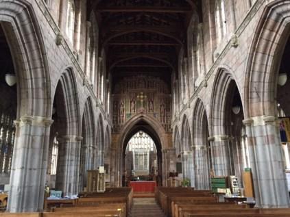 interior of Crediton Church showing pillars and pews