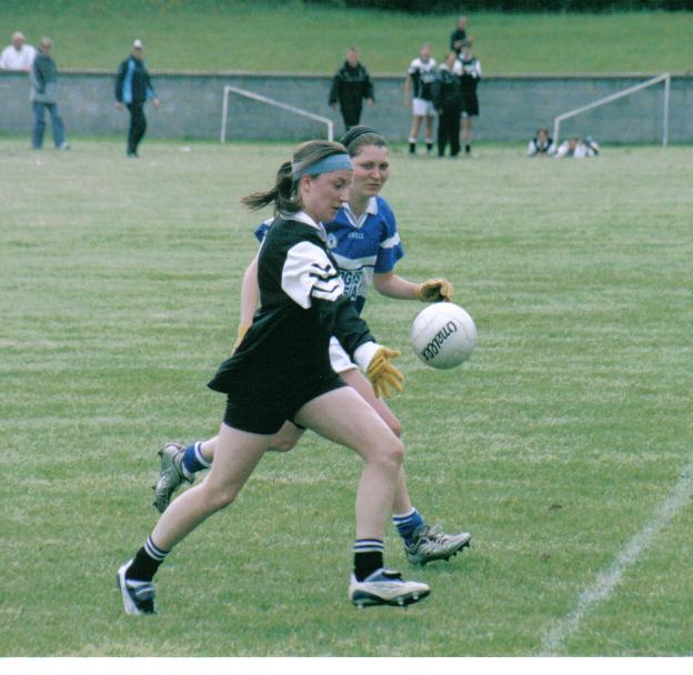 Killannin's Helen Fahy tracks the run of Gráinne Mhaols player Maryanna  McDonagh during the first half of the 2005 County Intermediate Championship final