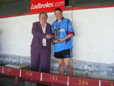 Connacht Council Chairperson, Geraldine Carey, presents Conamara full forward Mairead Coyne with the Player of the Match Award after the 2008 Connacht Junior Championship Final in Tuam Stadium.