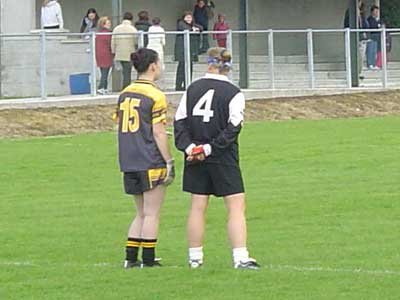 Grainne Mhaols corner back Lucy Lydon gets acquainted with the Bornacoola left corner forward prior to the commencement of their provincial semi final clash.
