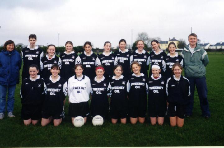 The first ever Grainne Mhaols Under 16A Panel which lost out to Dunmore in the 2003 County Championship. Back Row (L to R) Mary Young (Manager), Lisa McDonagh, Martha Folan, Mairead Coyne, Tara Staunton,Michelle Joyce, Josephine McDonagh, Leigh Birchmore, Nuala Gorham, Tara Flaherty and Paul Gannon (Manager and Coach). Front Row (L to R) Mary Joyce, Maryanna McDonagh, Becky Heanue, Noreen Coyne, Kim Young, Maire Coyne and Fionnuala Hannigan Dunkley.