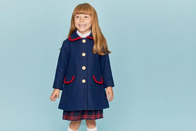 Girl wearing a blue coat.