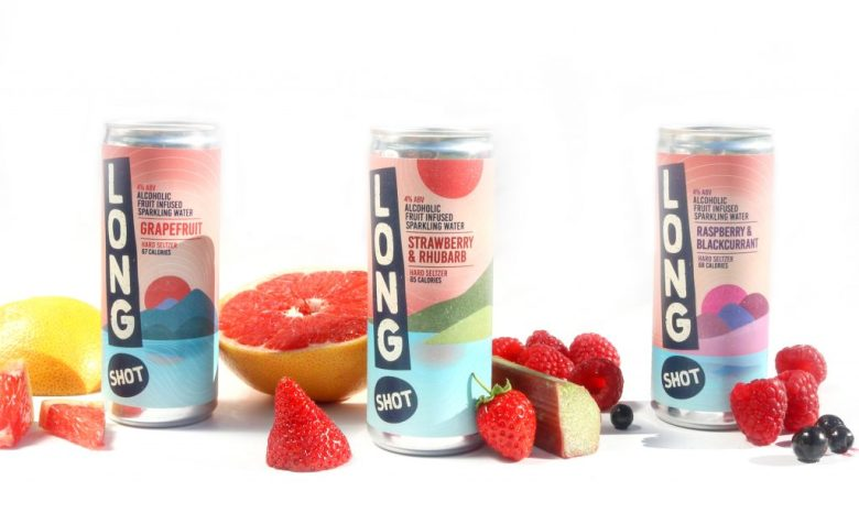3 cans of Long Shot fruit seltzer, surrounded by fruit.