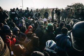 Refugees wait to be moved to centres around france on the day the camp is demolished. 25 Oct