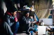 Kuwati men joke in their shelter in the Jungle. 26th Feb.