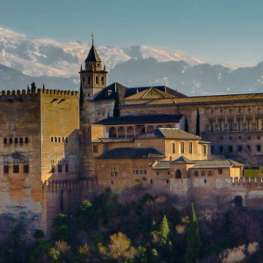 View of the Alhambra with the snowy peaks for the Sierra Nevada behind