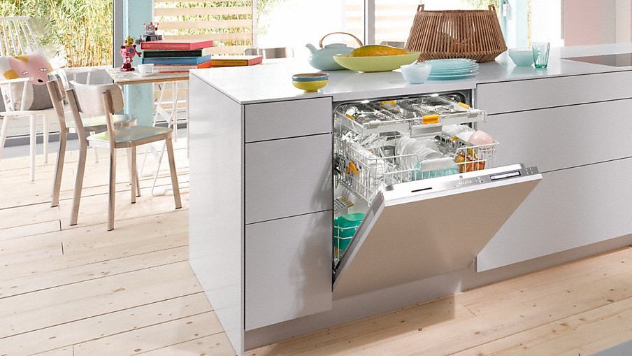 Miele 3-rack dishwasher with custom front set in modern kitchen.