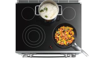 MCSA00777666_Bosch-Electric-Range-HEIP054U-Top-Cooktop-With-Food_def