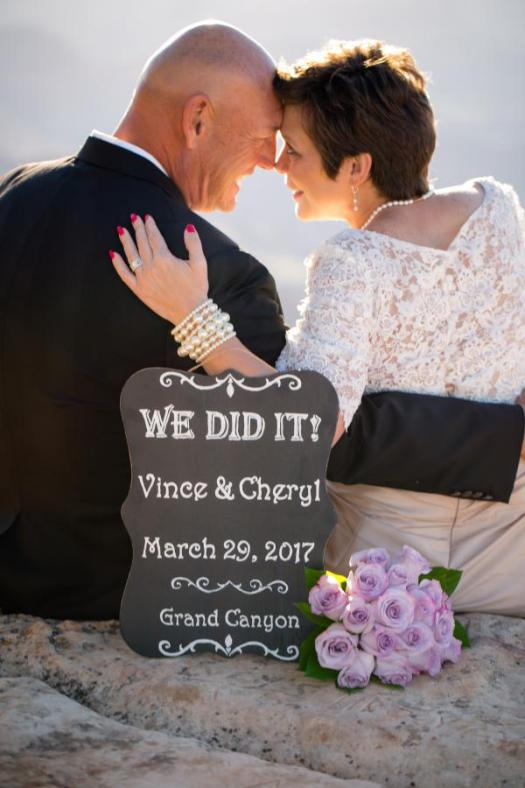 grand canyon wedding bride and groom with we did it sign