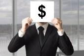 businessman hiding face behind sign dollar symbol