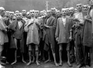 Starved prisoners, nearly dead from hunger, pose in concentration camp in Ebensee, Austria. The camp was reputedly used for