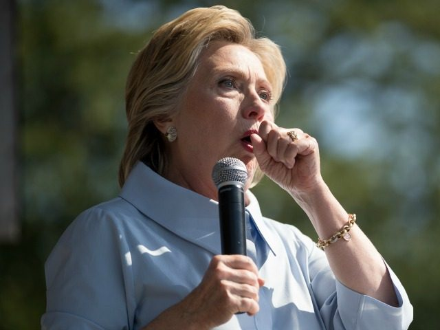 Democratic presidential candidate Hillary Clinton has to briefly stop her speech due to heavy coughing as she speaks at the 11th Congressional District Labor Day festival at Luke Easter Park in Cleveland, Ohio, Monday, Sept. 5, 2016. (AP Photo/Andrew Harnik)