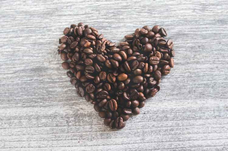 flatlay photo of heart shaped coffee beans