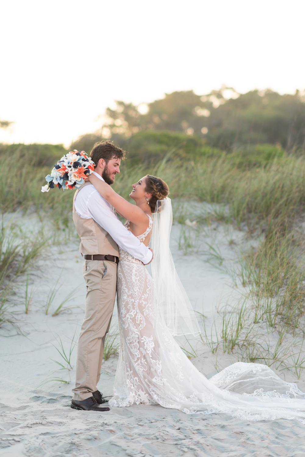 Bride and groom standing by the dunes - Grande Dunes Ocean Club - Myrtle Beach
