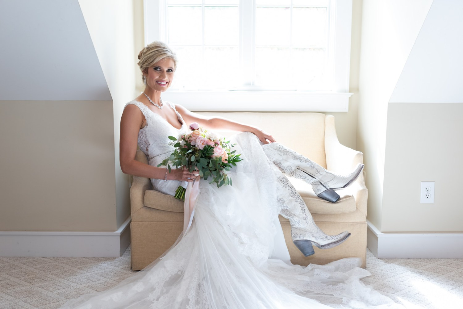 Bride posing with her cowboy boots - Brookgreen Gardens