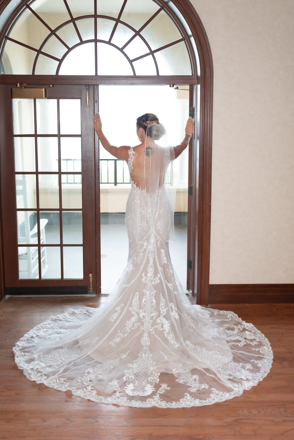 Bride standing in doorway - Grande Dunes Ocean Club - Myrtle Beach