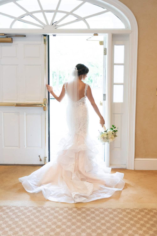 Bride standing in doorway light - Pawleys Plantation