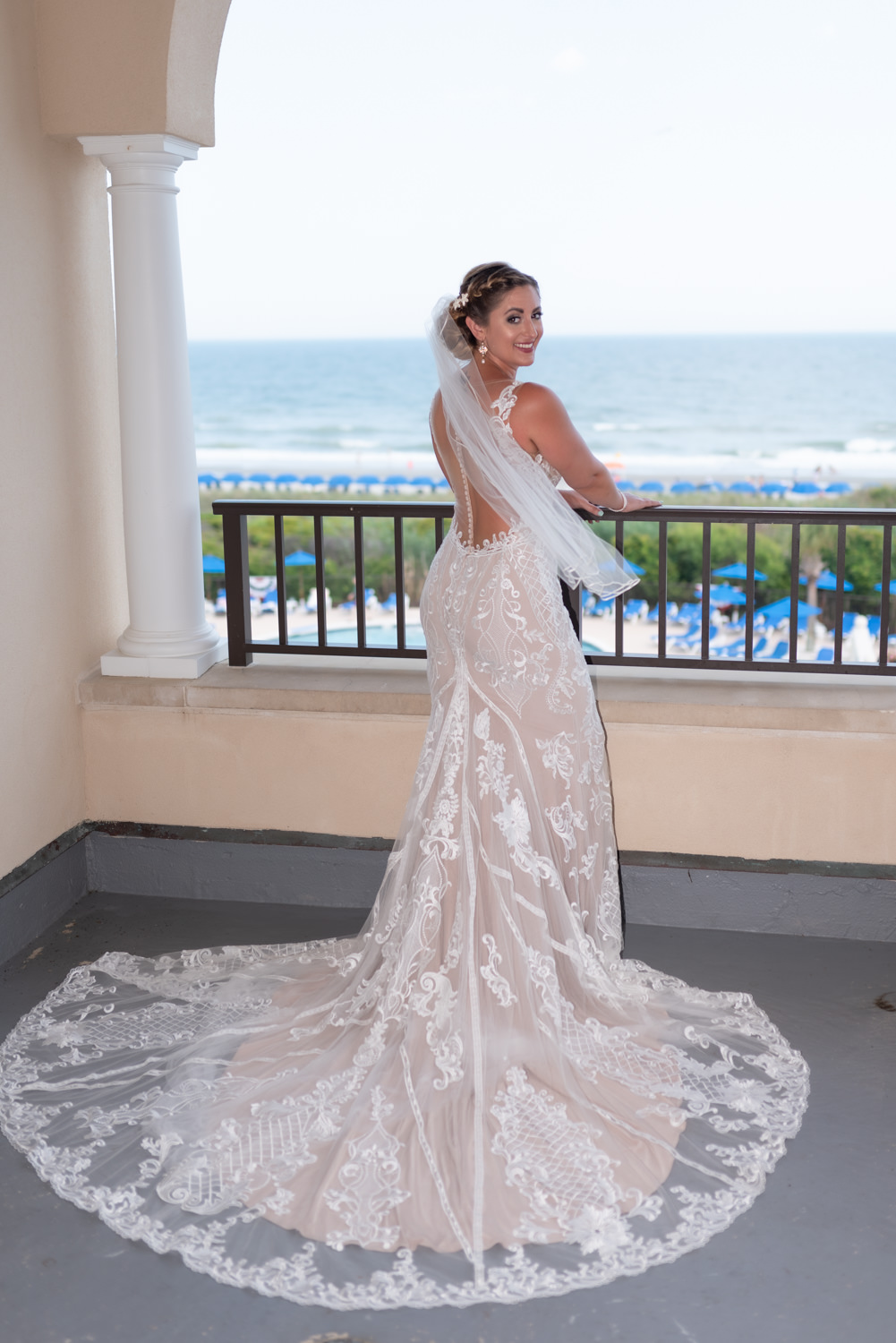Bride standing on the balcony - Grande Dunes Ocean Club - Myrtle Beach