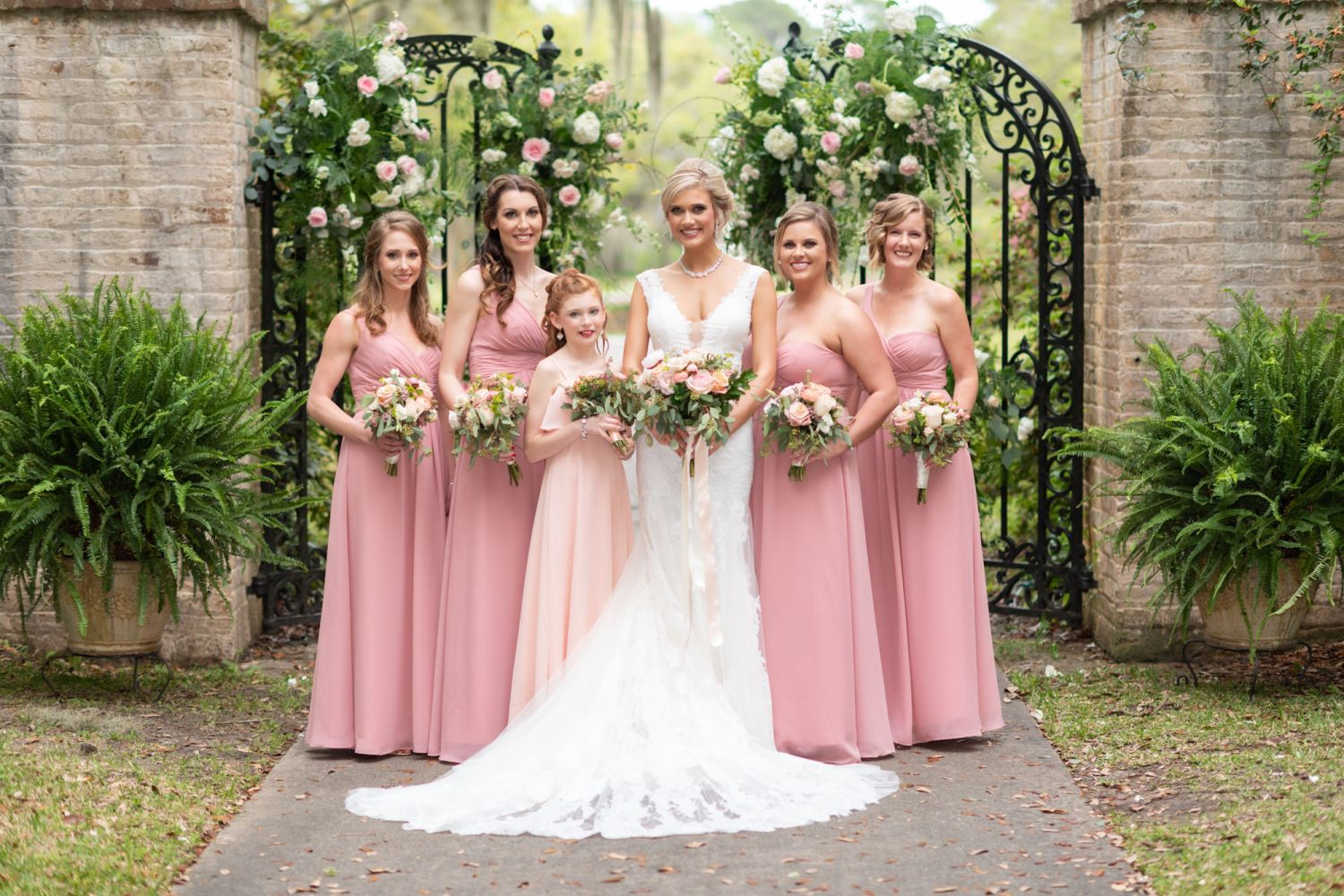 Bridesmaids and bride standing by the gates - Brookgreen Gardens