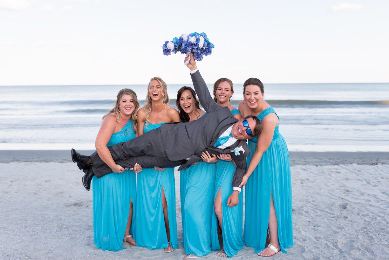 Lifting up the groom - Grande Dunes Ocean Club