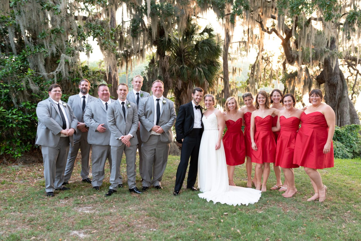Bridal party under the moss from the oak trees at sunset - Wachesaw Plantation