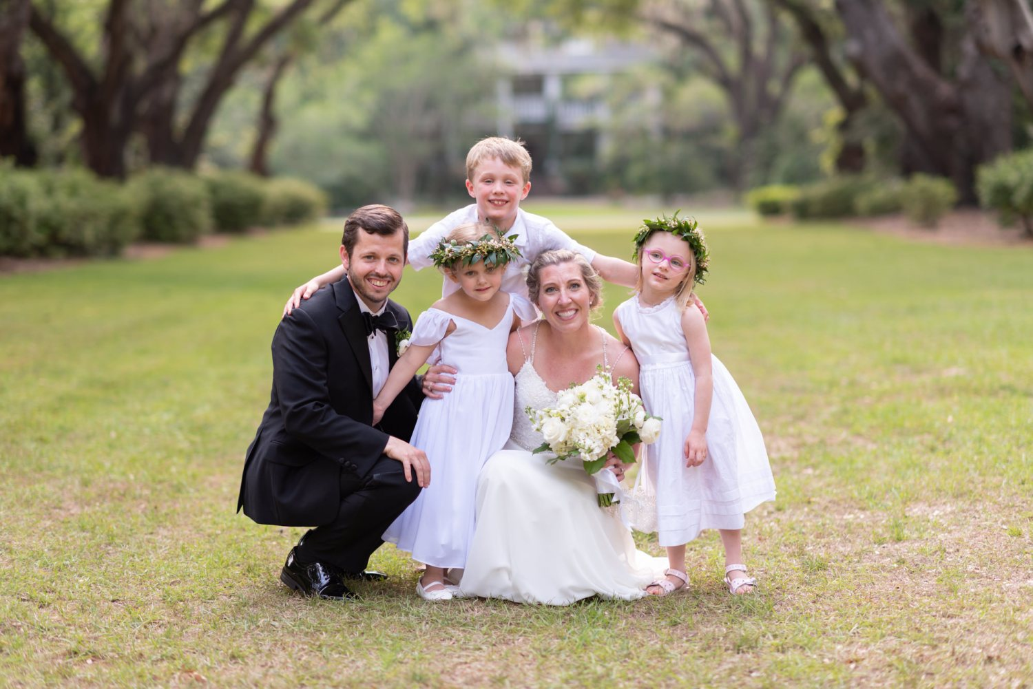 Bride and groom with the kids - Wachesaw Plantation