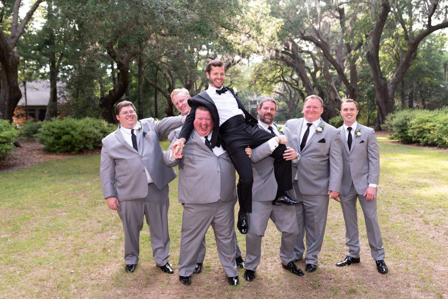 Groomsmen lifting up the groom - Wachesaw Plantation