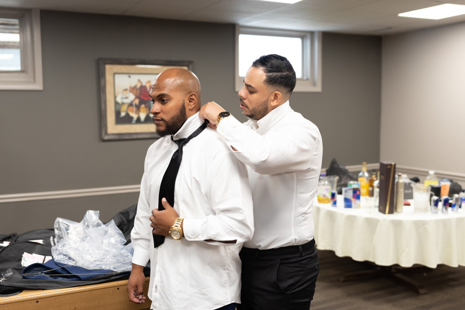 Groom helping best man with his tie - Litchfield Country Club
