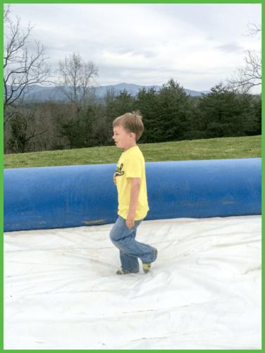 Cute Little Boy Walking on Slide