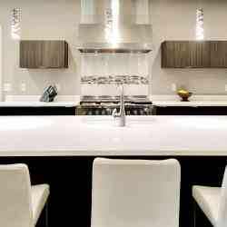 Black and white kitchen with white quartz countertop and island