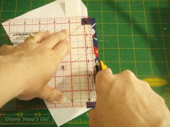 Fold back the paper and the piece you have just sewn, and trim the seam allowance to a neat ¼ inch.