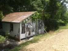 old house on river side of levee 6-21-13