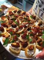 Our first appetizer, toasted crostini with goat cheese, figs, Serrano ham and fresh mint.