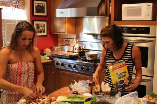 Dea and Lisa prepare appetizers before the guests arrive.