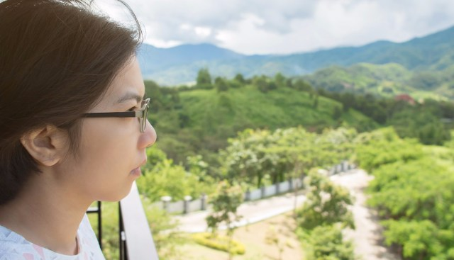 Asian woman looking on the landscape.