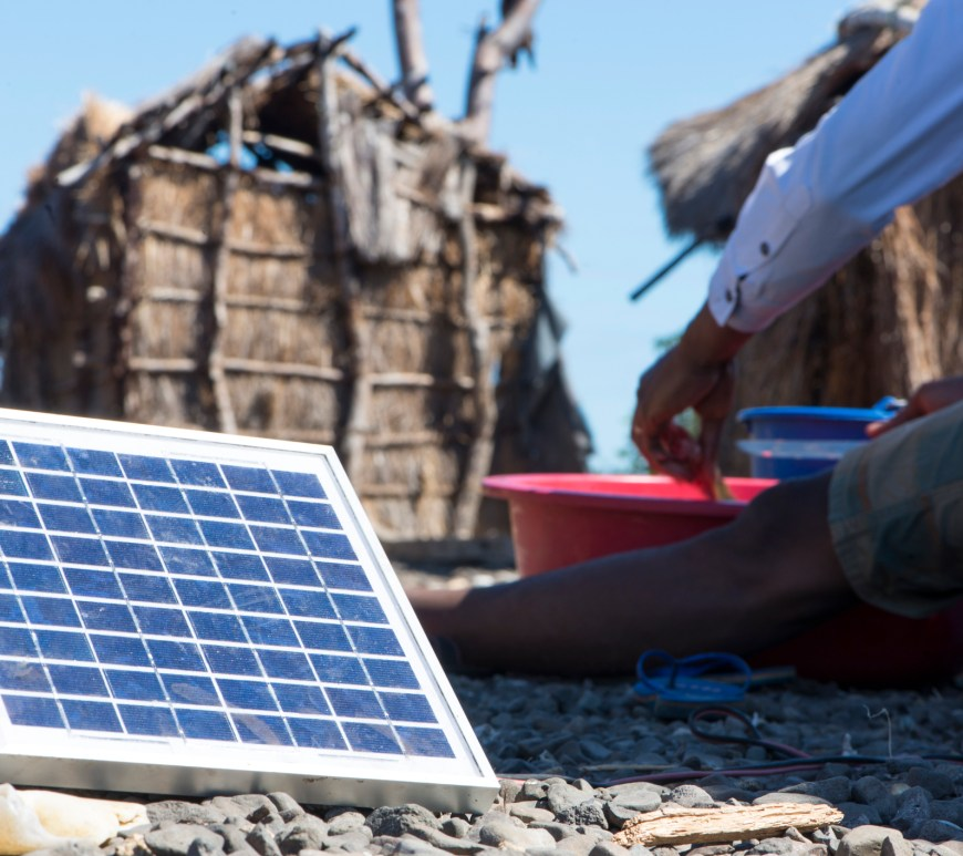 Small solar panel on the floor in an African village, Madagascar